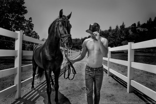 One man with his horse as lifestyle designer fashion model at ranch in Los Angeles photo by Meg N Commercial Photography.